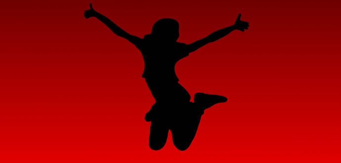 ジャンプする女性のシルエット